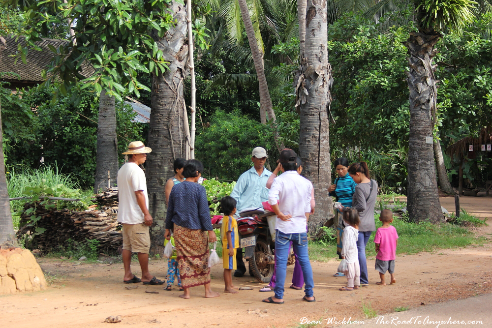 Group of people chatting at a village in Cambodia