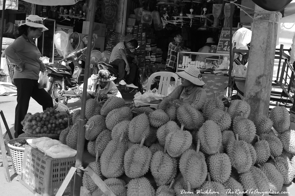 Ladies selling durians in Kampong Cham, Cambodia