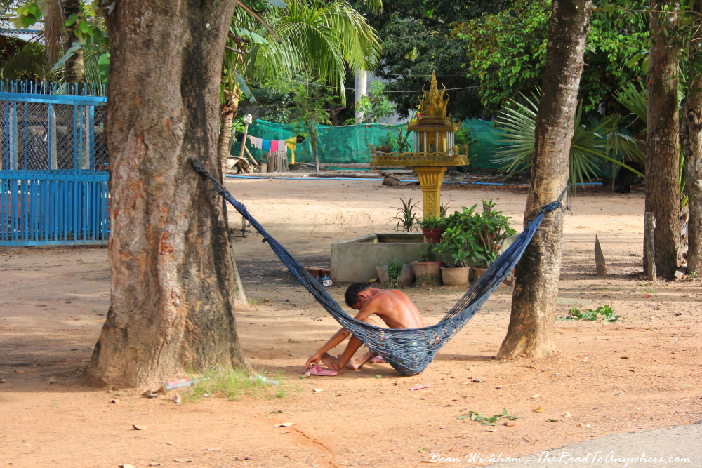 Man sitting in a hammock in Cambodia