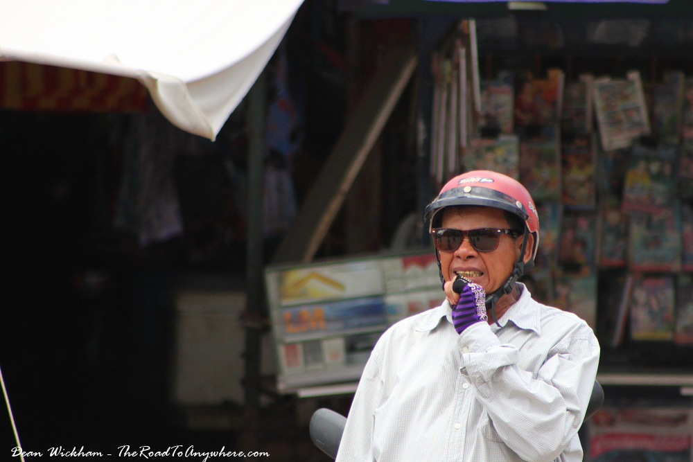 A man with a helmet on in Battambang, Cambodia