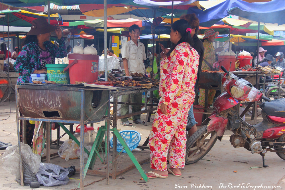 People chatting at a market in Kratie, Cambodia