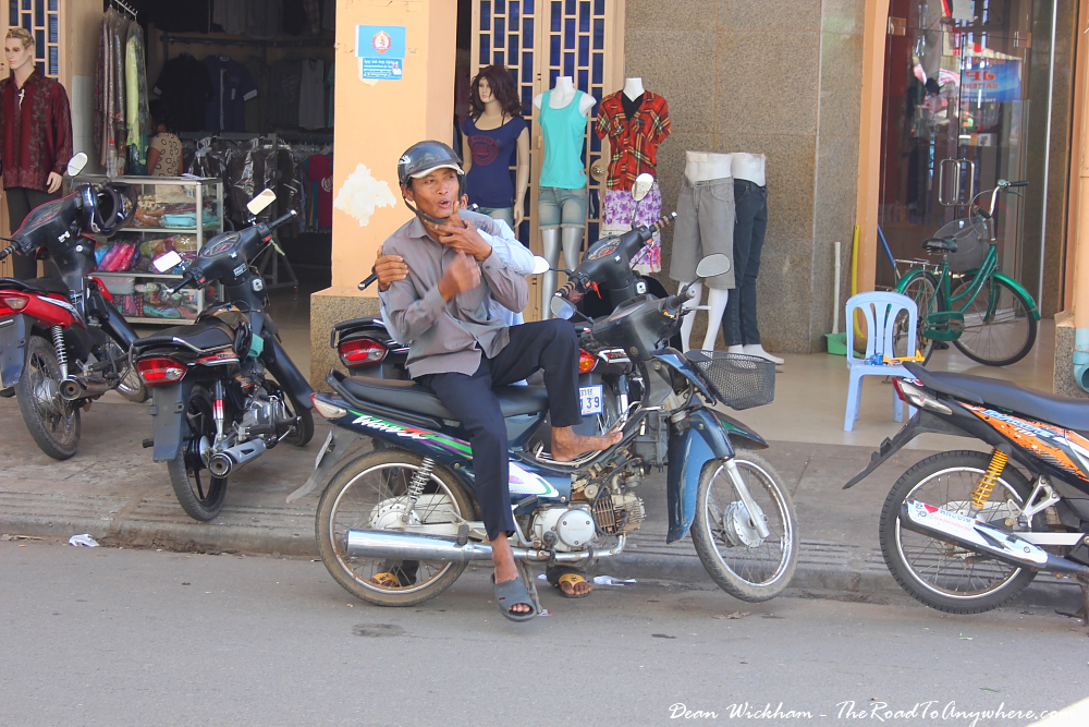 Two guys having fun for a photo in Kampong Cham, Cambodia