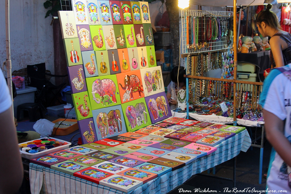 Paintings for sale at the Sunday Market in Chiang Mai, Thailand