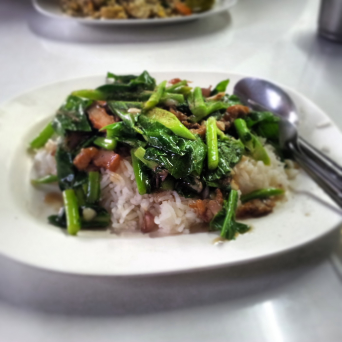 Crispy pork and greens on rice in Chiang Mai, Thailand