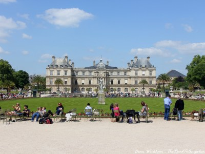 People relaxing in front of Luxemboug Palace in Jardins du Luxembourg, Paris