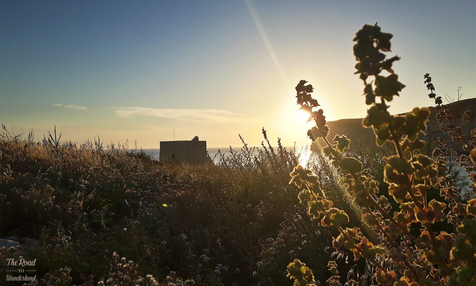 Xlendi cliffs and tower at sunset