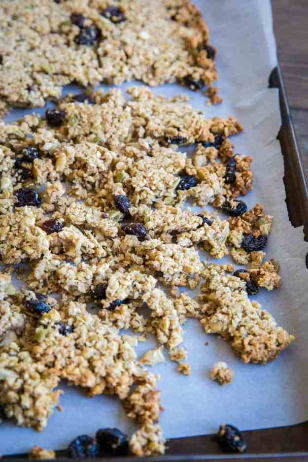 Grain-Free Paleo Granola made with nuts and seeds. This refined sugar-free recipe yields huge granola clusters and is super crunchy and delicious for breakfast or snack