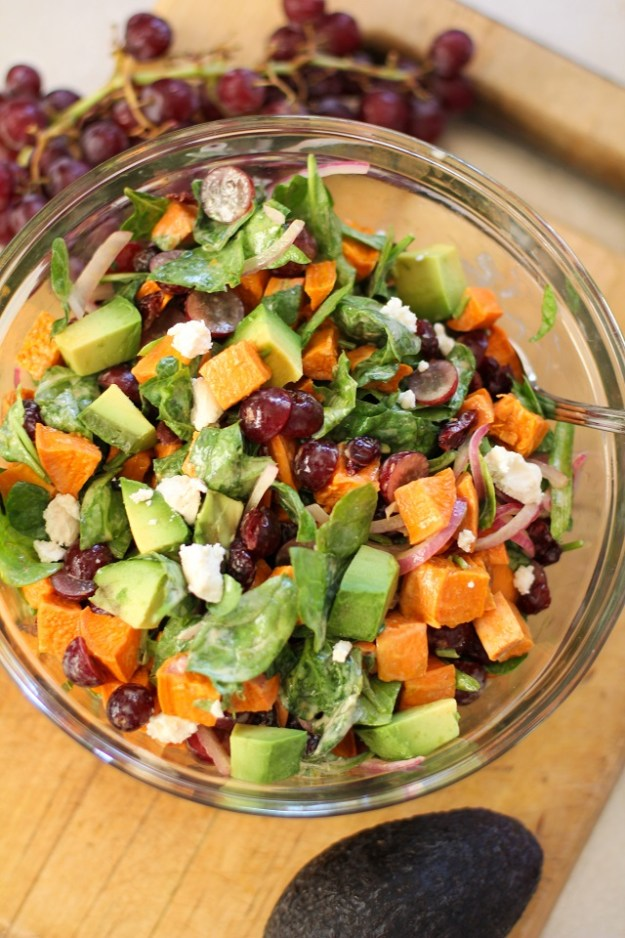 Roasted Sweet Potato Salad with Spinach, Grapes, Dried Cranberries, and Avocado | theroastedroot.net #vegan #vegetarian #healthy #recipe