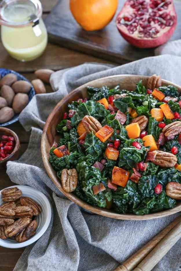 Roasted Butternut Squash Kale Salad with Pecans, Pomegranate Arils, Bacon, and Orange Vinaigrette - a perfect holiday side dish or entree this fall and winter