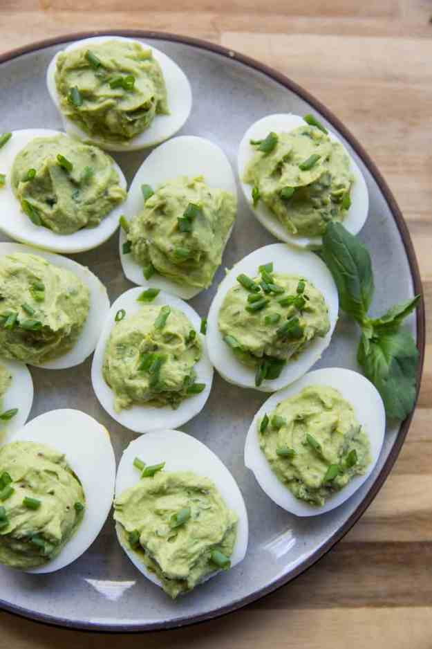 Avocado Pesto Deviled Eggs - Mayo-free deviled eggs made with avocado and fresh basil for a healthy snack or appetizer | TheRoastedRoot.net