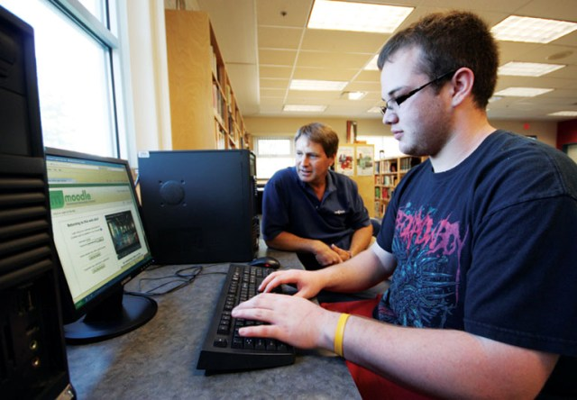 Gage Ringer works on his Digital Photography course with the help of Valemount teacher Dan Lawless.