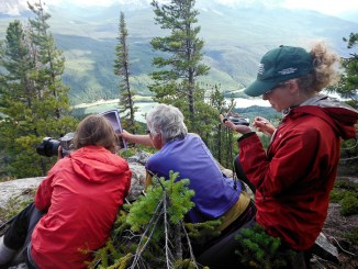 Researchers use GPS to recreate photographs taken of Mt Robson 100 years ago from the Ptarmigan Peak Station.