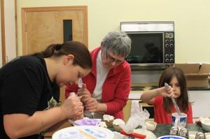 cupcake, icing, family, volunteer, dessert, decorating, helping, help, piping, kitchen, women, ladies, female