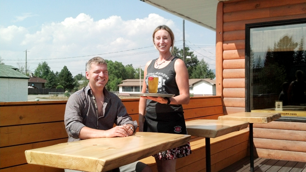 Mayor Andru McCracken enjoys first pint on 3 ranges patio