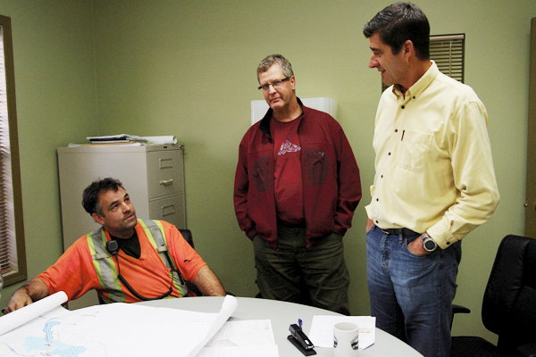 Rob Pepper chats with Jeff McWilliams (centre) and Wes Bieber (right) about the Community Forest's tentative winter harvest plans at an open house last week.