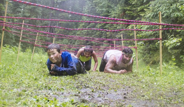 Shortly after, Jerome, Ilnicki and teacher, Dustin Winzer, climb underneath another obstacle.
