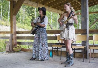 Photo: Evan Matthews Raven Moon (left) and Carolyn Kirk (right) play the RVMF's Earthship stage on Sunday afternoon.