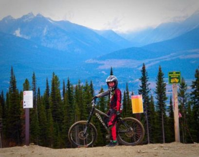 Photo: Alicia Hill Riley Hill poses for a photo before his first run down the new Downhill Trail.