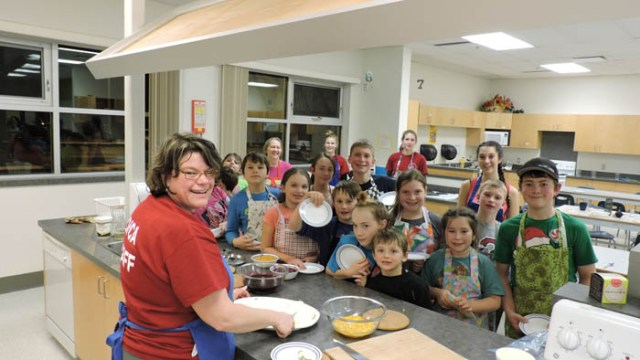 Photo: Alicia Hill Kinnikinnickers put on a cooking class for nine- to 12-year-old kids, which was held at the secondary school. Roxie Smid taught the class. Many of the kids expressed how much they enjoyed the class, and all that they learned. Smid says they will be putting together another class for January.