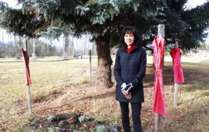 Photo: Evan Matthews The fence post in the distance is empty, Tinsley says, in memory of the first dress she ever hung in memory of MMIW outside her shop. One evening, someone took the dress, which she says felt like someone stole that girl all over again.