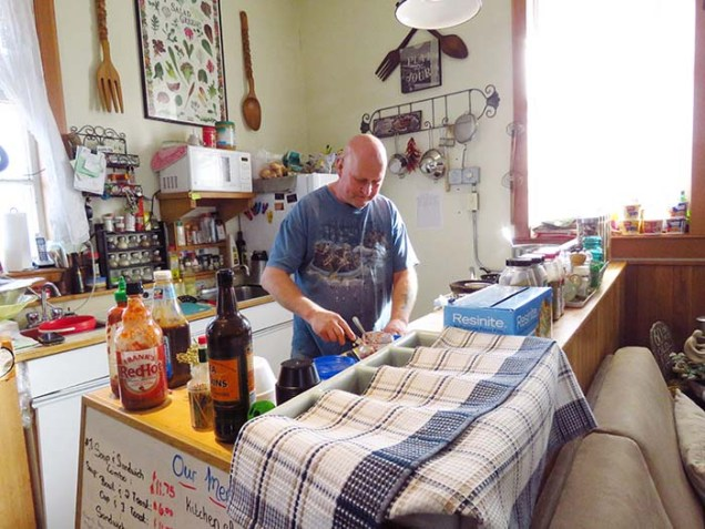 Andy prepares a sandwich at the Beanery 2. He has been able to continue his love of food and service in the Robson Valley alongside his partner Donna Perkins. /ANDREA ARNOLD