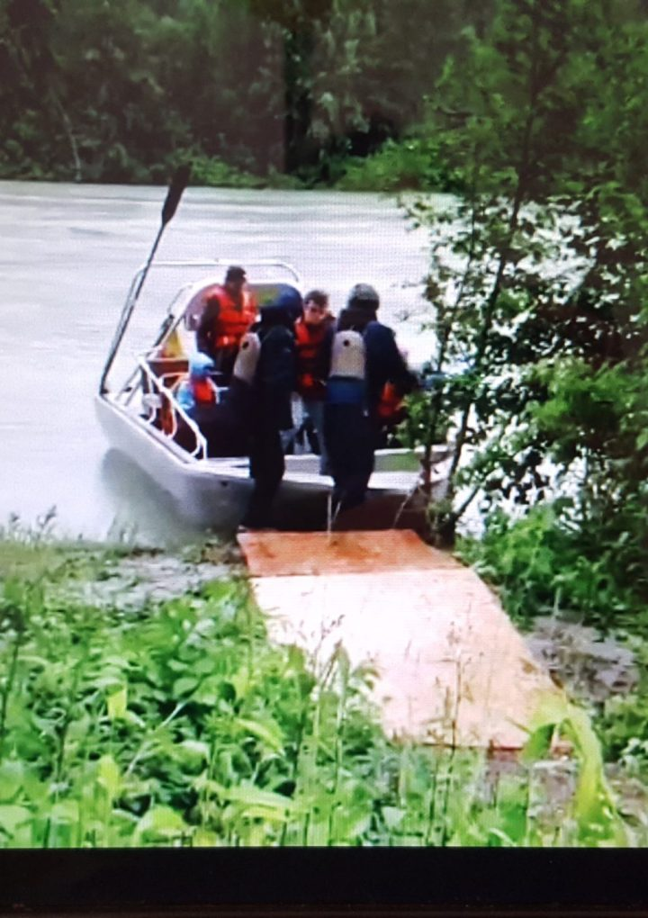 Water taxi links residents trapped by slide to essential services