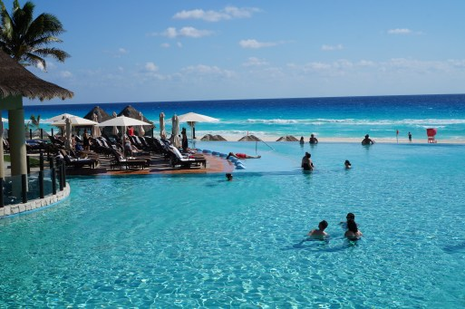 Enjoying This Resort's Ocean-Blue Infinity Pool