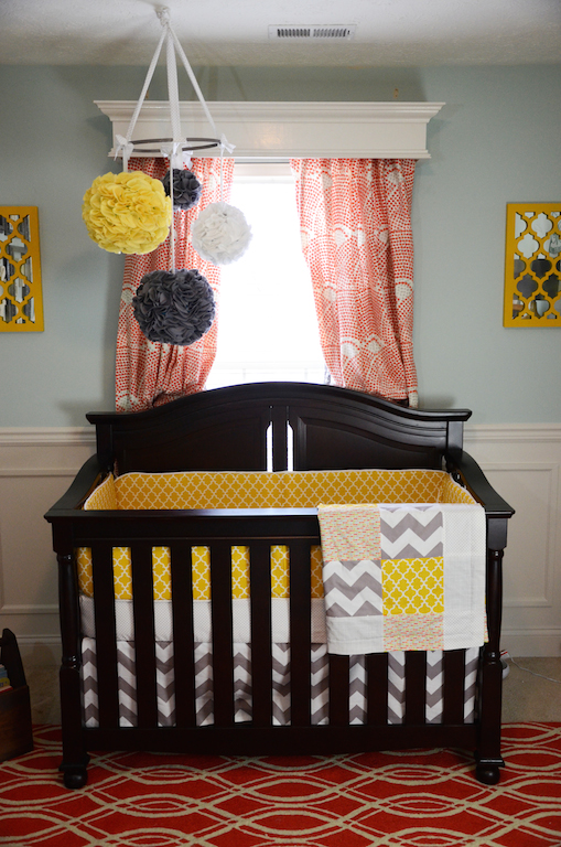Modern Gender Neutral Baby Nursery Crib in Front of Window with Cornice