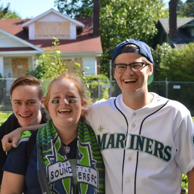 Seniors Henry Whitmarsh, Emma Huebler, and Conor Courtney support Seattle sports