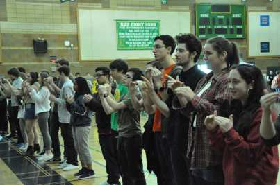 ASL signs the Pledge of allegiance to kick off the assembly