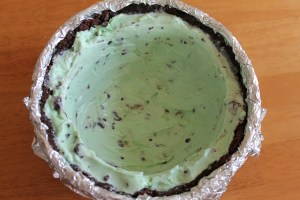 Add a layer of mint ice cream. Freeze until firm.