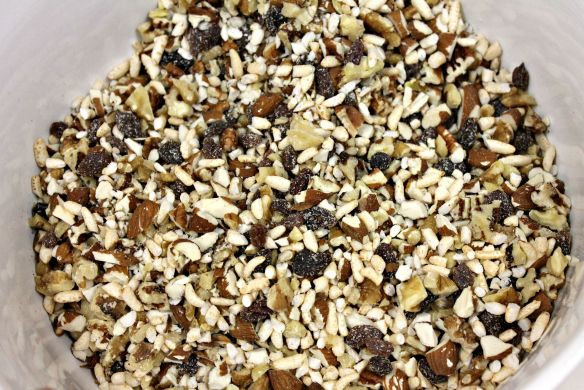 Combine chopped nuts, raisins, and rice puffs.
