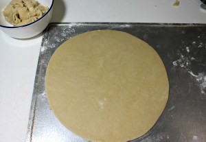 Cut top crust a little bigger than the pie pan. Lift with rolling pin and place over filling. Crimp edges and bake.