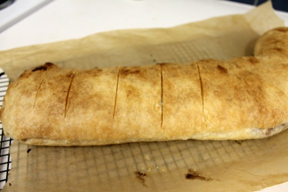 Score the baked strudel and let it cool a bit before cutting
