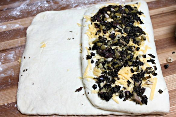 Add remaining cheese and olives and fold left side over the mixture. Pinch to seal.
