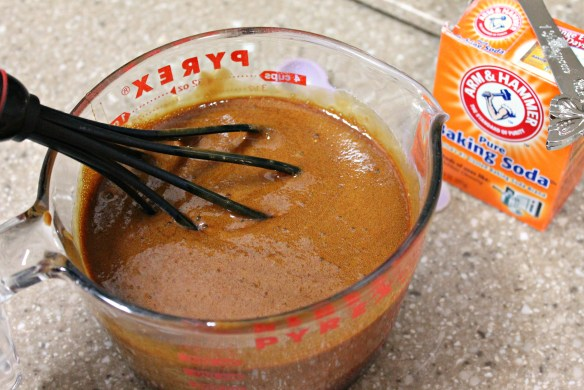 In a small bowl, whisk baking soda into molasses and sour cream.