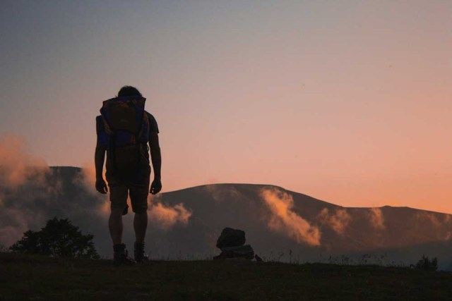 Backpacker at night in the mountains