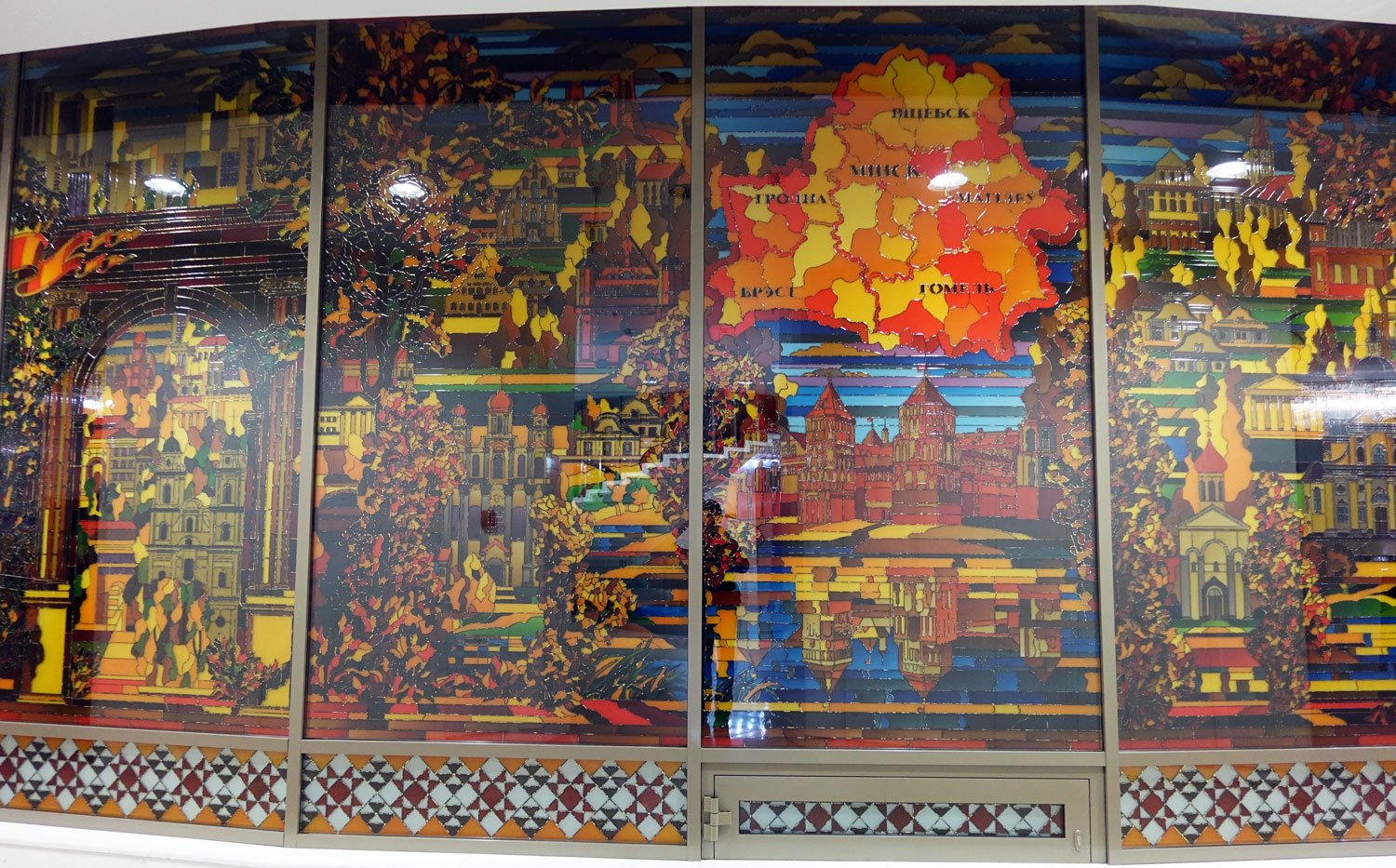 hotel belarus minsk rose windows which show scenes from the nation's history.