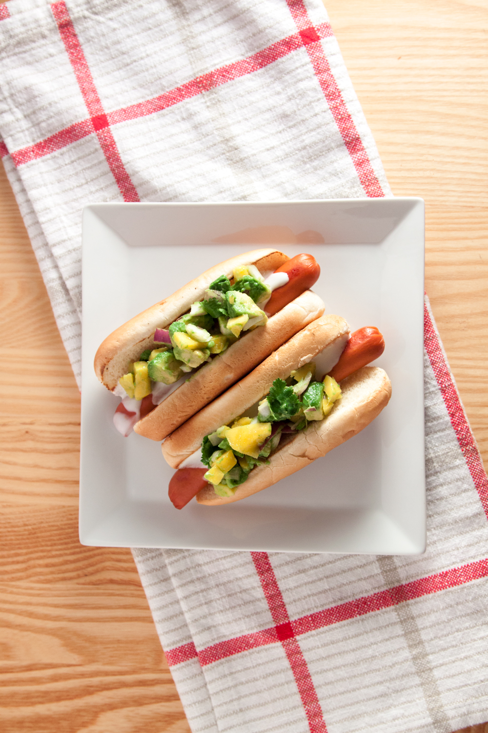 Hot dogs with mango salsa