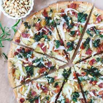 potato kale and rosemary pizza sliced
