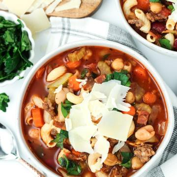 Minestrone Soup in a bowl with parmesean cheese