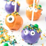 Orange and Purple chocolate cake pops with sprinkles and monster eyes