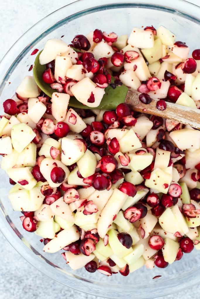 Cranberries, apples, and pears in a bowl.