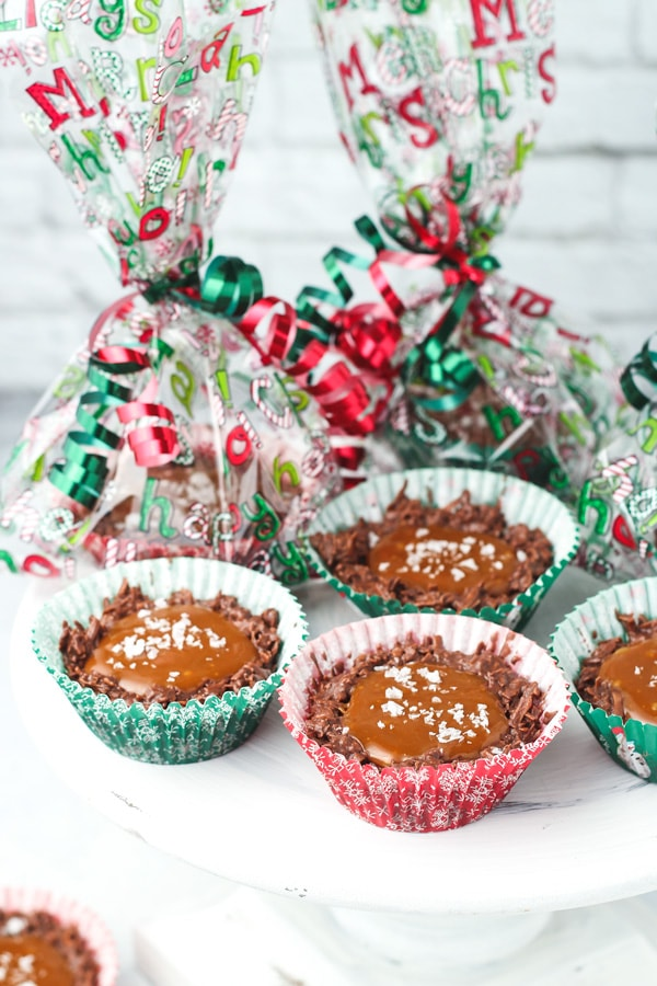 Christmas treat gift bags with coconut clusters in cupcake liners with caramel and sea salt.