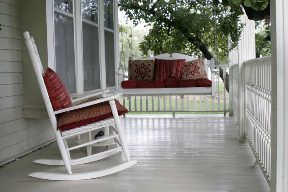 red cushions white porch furniture