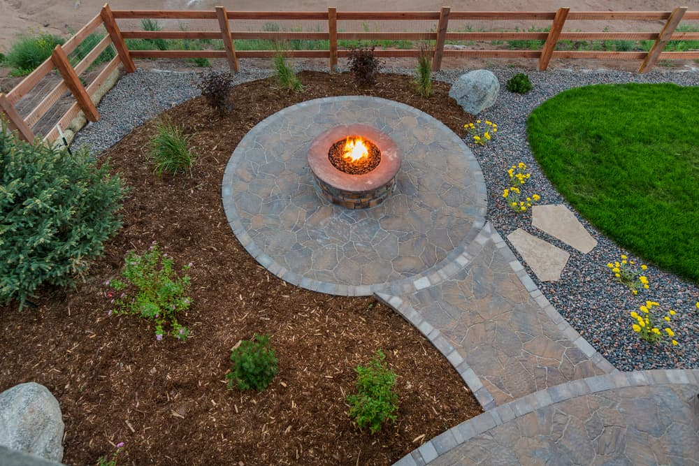 extended patio with fire pit