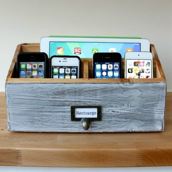DIY Phone Charging Station Store all your phones in this DIY charging station when they aren't in use. Using a charging station will keep the clutter off your counter or desk too. Take a look to see how to make your own. thesawguy.com