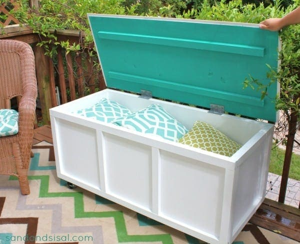 DIY Outdoor Storage Bin & Bench This storage bin is so attractive and it can hold a lot of things! Hide your kid's balls, toys, or gardening tools in this sleek bench. These are especially helpful if you have a very small yard, limited storage or your patio. thesawguy.com