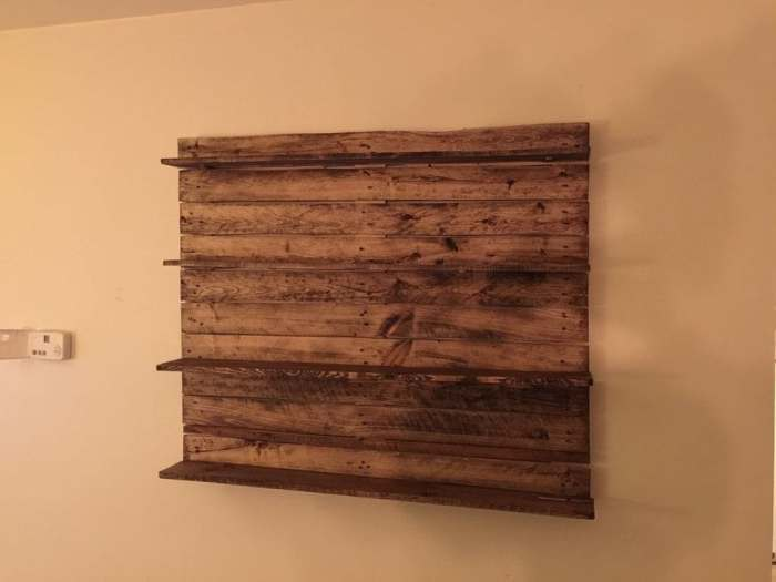 Pallet Wall Shelf The rustic style of this pallet wood wall shelf is perfect! Hang this in your bathroom, living room, or even your office for a farmhouse style. You can put anything from towels to coffee cups on the shelf and it is going to look fantastic.thesawguy.com