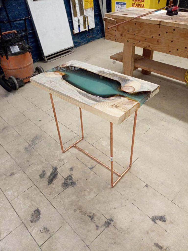 The industrial style of this resin river table is top of the line! Everything about it from the color to the size is perfection. You really need to look at this tutorial. thesawguy.com